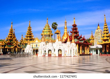 Golden stupas in Shwedagon Zedi Daw (Great Dagon Pagoda, Golden Pagoda), Yangon, Myanmar. On blue sky background