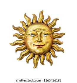 Golden sun face symbol with sunrays isolated on white. Wooden decor ornament symbol painted on gold paint. Summer weather and heat sign