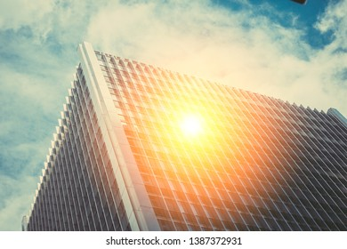 Golden sun ray reflection on modern building