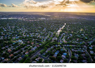 Golden sun rays or god beams Sunset real estate suburb homes. Community suburbia neighborhood in north Austin in suburb Round Rock , Texas Aerial drone view above new development