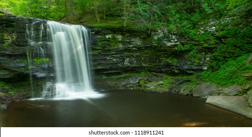 Golden sunbeams and a waterfall