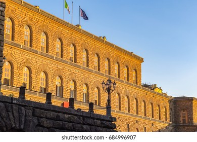 Golden sunlight hit the facade of Palazzo Pitti (Pitti Palace) in Florence, Italy at sunset