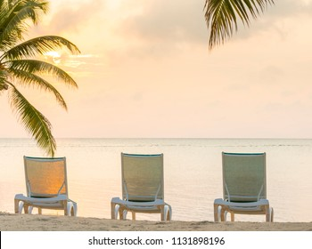 Golden sunlight over palmtrees on tropical beach resort with copy space