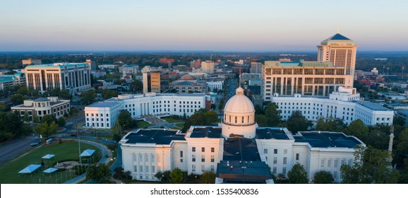 Golden sunlight reaches the horizon showing around the capital statehouse in Montgomery Alabama