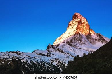 Golden sunlight shine on Matterhorn in early morning, Zermatt, Switzerland