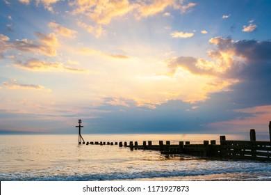 A golden sunrise at Bacton beach