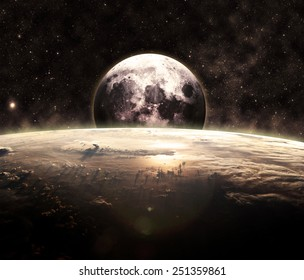 Golden Sunrise and the Moon - Elements of this Image Furnished by NASA