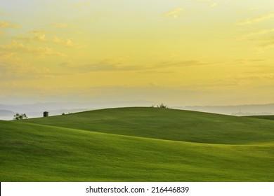Golden sunrise on golf greens, Philippines