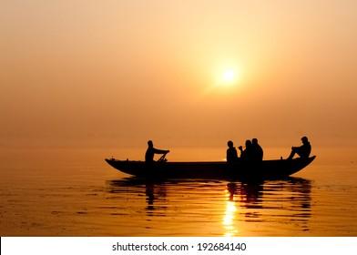 Golden sunrise on the river Ganges in Varanasi