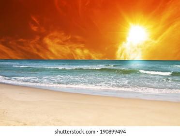 golden sunrise over blue sea