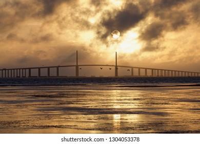 A Golden Sunrise Over the Bridge