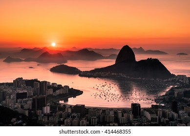 Golden Sunrise over Guanabara Bay in Rio de Janeiro with Sugarloaf Mountain in the Horizon