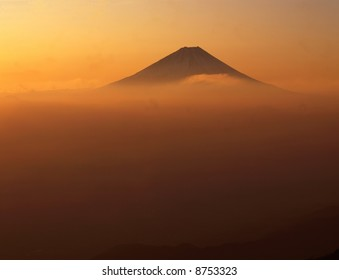 Golden sunrise over Mt. Fuji as viewed from an adjacent peak