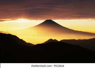 Golden sunrise over Mt. Fuji as viewed from an adjacent peak