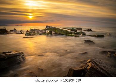 Golden sunset in basque coast