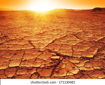 Golden sunset at a desert. Dry and thirsty soil.