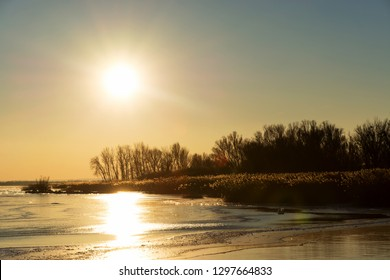 Golden sunset at Lake Balaton in winter time, Hungary