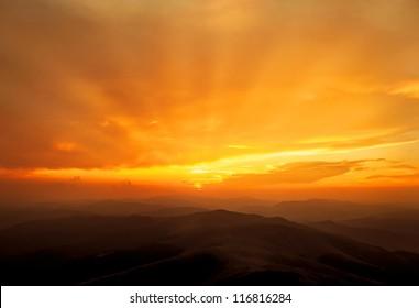 Golden sunset over Carpathian mountains. Borzhava ridge. Ukraine