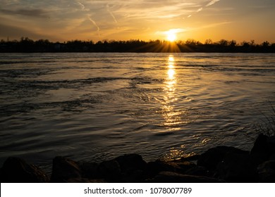 Golden sunset over the Niagara River from a park in Buffalo N.Y.