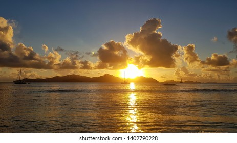 golden sunset over praslin island seen from la digue island in Seychelles