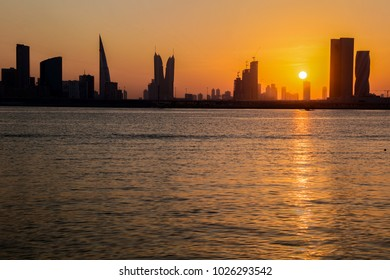 A golden sunset puts on a show for Manama, Bahrain.