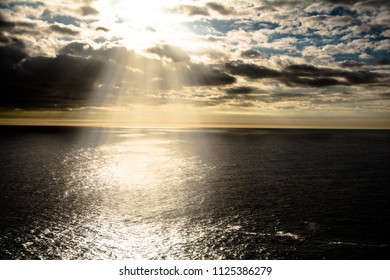 Golden sunset rays over a calm ocean