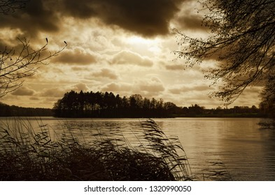 Golden sunset reflecting in a water of a lake. Siek county in north Germany
