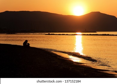 Golden sunset as seen from Latchi beach over the hills of Akamas peninsula, Cyprus