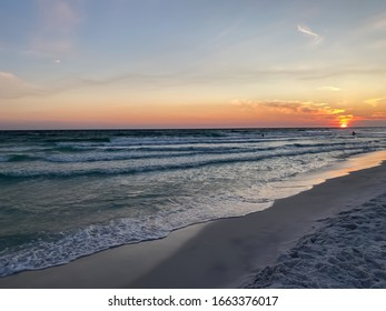 Golden sunset skies on the beach with sun dipping low on the horizon