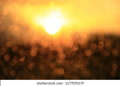 Golden sunset through window. Bright bokeh. Golden bokeh. Texture with gold abstraction. Creative abstract golden patterned background. Gold bokeh