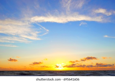 Golden sunset tropical sea background.