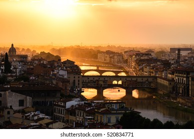 Golden sunset and view of Florence city. Panoramic view to the river Arno, with Ponte Vecchio, Palazzo Vecchio and Cathedral of Santa Maria del Fiore (Duomo), Florence, Italy. Romantic getaway.