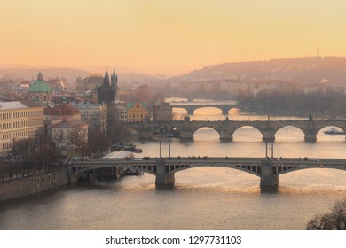 Golden sunset view of Prague from Letna park with bridges over Vltava river and Charles bridge. Prague. Czech Republic.