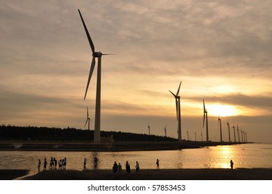 a golden sunset at the wind-power station
