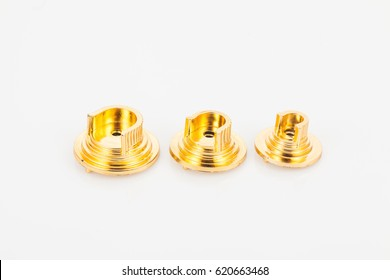 Golden support for curtain poles on white background