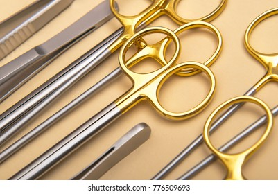 Golden surgical instruments. Close up image of stainless steel operating tools.