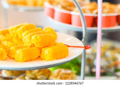 Golden sweet egg floss or Foi thong in Thai language.Portuguese dessert made from egg yolks on ceramic stack cake plate for party attendees.Copy space for add texts.Food and snack concept.