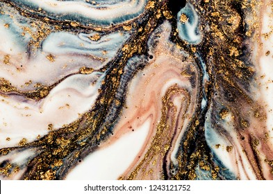 Golden swirl, artistic design. Painter uses vibrant paints to create these magic art, with addition golden glitters, lines. ART&GOLD.  Masterpiece of designing art. Eastern style.