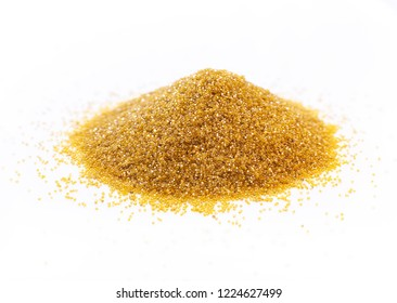 golden synthetic diamond powder on a white background
