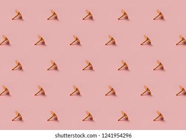 Golden tack pattern on pink background horizontal lines