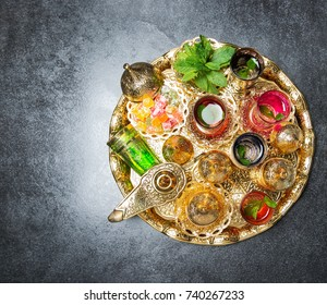 Golden tea table decoration. Arabic traditional dishes. Ramadan kareem. Top view