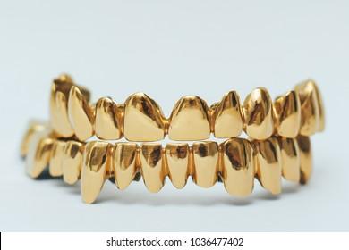 Golden teeth grillz