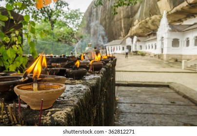 Golden Temple buddhist caves, signs of worship - Dambulla, Sri Lanka