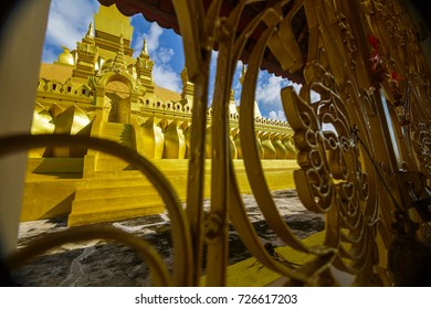 Golden temple gate at Pha That Luang, a Buddhist pagoda in Vientiane, Laos