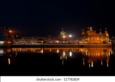 Golden Temple under night sky. Holy Sikh Place Harmandir Sahib Gurdwara. India, Amritsar, Punjab