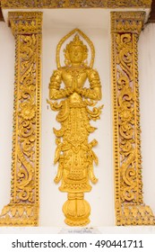 golden thai angel sculptures stucco on the temple walls