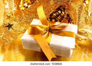 golden theme details with a gift