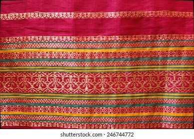 Golden thread design work on red border of Indian Silk Sari