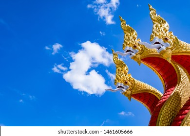 golden three headed Naga and with blue sky and cloud background
