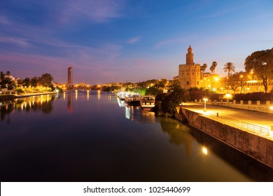 Golden Tower in Seville at evening. Seville, Andalusia, Spain.